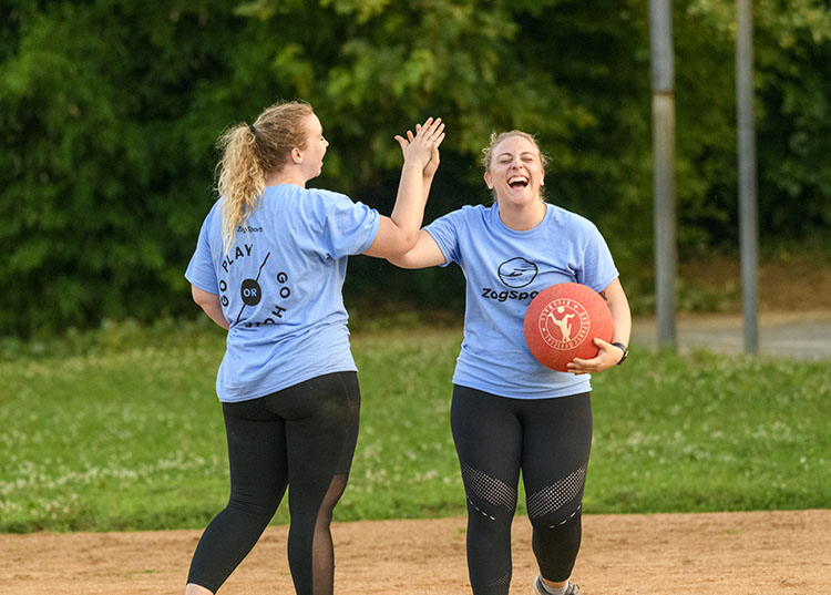 kickball teammates high-five